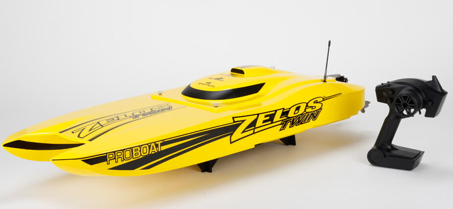 Pro Boat 08021 Zelos 36-inch Brushless Twin Catamaran RTR This is Pro Boat 08021 Zelos 36-inch Brushless Twin Catamaran RTR. Features includes Powerful Twin, 36mm x 62mm counter-rotating brushless 6-Pole, 2000Kv motors, two 120-AMP (6S LiPo compatible) Brushless Water-cooled ESCs, capable of reaching speeds in excess of 60 MPH with recommended 6S LiPo batteries, precision catamaran hull, fiberglass canopy, stainless steel propellers, Spektrum™ DX2E Transmitter, waterproof electronics, boat stand included.Condition: Factory NewOperational Status: FunctionalThis item is brand new from the factory.Original Box: YesManufacturer: Pro BoatModel Number: 08021MSRP: $749.99Category 1: Other ToysCategory 2: Radio Control ToysAvailability: Ships in 1 Business Day!The Trainz SKU for this item is P12181999. Track: 12181999 - No Location Assigned - 001 - TrainzAuctionGroup00UNK - TDIDUNK