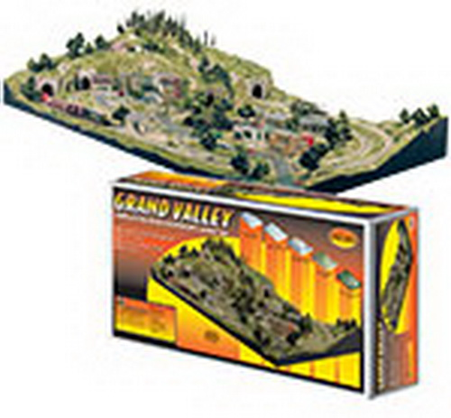 Woodland Scenics ST1483 Grand Valley HO Scale Layout Kit Grand Valley is a complete 4x8 foot HO scale lightweight layout kit. Risers and inclines create hills, mountains and low lying areas. Foam sheets make flat, elevated areas for towns and buildings. Use plaster cloth to create a hard terrain covering. Make and install rocks, add tunnel portals and culverts. Add roads and landscape with a wide variety of scenery products. The sturdy, completed layout needs no plywood base or additional structural support. For displace purposes, use square module kit stands.Condition: Factory New (C-9All original; unused; factory rubs and evidence of handling, shipping and factory test run.Standards for all toy train related accessory items apply to the visual appearance of the item and do not consider the operating functionality of the equipment.Condition and Grading Standards are subjective, at best, and are intended to act as a guide. )Operational Status: FunctionalThis item is brand new from the factory.Original Box: Yes (P-9May have store stamps and price tags. Has inner liners.)Manufacturer: Woodland ScenicsModel Number: ST1483MSRP: $599.99Scale/Era: HO ModernModel Type: BuildingsAvailability: Ships in 1 Business Day!The Trainz SKU for this item is P11542590. Track: 11542590 - S98 (Shelf)  - 001 - TrainzAuctionGroup00UNK - TDIDUNK
