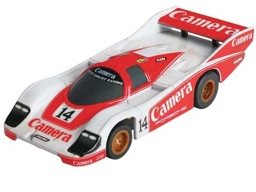 AFX 21011 HO Slot Car Mega-G Porsche 962 #14 This is an AFX 21011 HO Scale Slot Car Mega-G Porsche 962 #14. Featuring Correctly Proportioned Body • Stunning Detail • Up to 8-Color Graphics • Fastest Production Chassis Ever Made Mega-G Chassis Specific Features: • Weight: Up to 30% Lighter Than Any Other HO Chassis – Way More Fun to Drive • Size: Lowest and Narrowest Chassis Ever Made – Much More Realistic Bodies • Center of Gravity: Lowest of All Competitors – Corners Better Than Any Other Chassis • Wheelbase: Longest Available – Better Proportioned Bodies • Guide Pin: Exclusive Extra Long Tapered Guide Pin – Car Stays in the Slot Longer • Unique Monocoque Chassis: Lighter and Stronger – Out-Handles the Competition • Ground Effects Magnets: Level 30 Neodymium – Stays Glued to the Track • Pick-Up Shoes: High Conductivity Phosphor Bronze – Gets More Power to the Motor • Chassis Material: Nylatron – Super Strong and Tough • Motor Armature: Precision Balanced – Revs to the Moon, Reliably • Motor Magnets: Polymer – Up to 20% More Powerful Than Larger Ceramic Mag Scale: 1/64Condition: Factory NewOperational Status: FunctionalThis item is brand new from the factory.Original Box: YesManufacturer: AFXModel Number: 21011MSRP: $54.17Category 1: Other ToysCategory 2: Slot CarsAvailability: Ships in 1 Business Day!The Trainz SKU for this item is P12067911. Track: 12067911 - S01 (Shelf)  - 001 - TrainzAuctionGroup00UNK - TDIDUNK