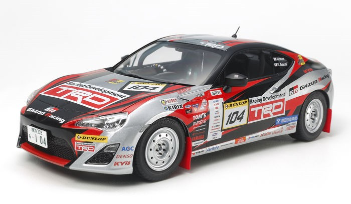 Tamiya 24337 1/24 2013 TRD86 Gazoo Rally Race Car This is a Tamiya 24337 1/24 2013 TRD86 Gazoo Rally Race Car. The Toyota 86 was released in April 2012, a front-engine rear-wheel drive sports car powered by a 2.0-liter four-cylinder engine. Since then it has also enjoyed popularity in motorsports, including this GAZOO Racing vehicle entered in the 2013 TRD Rally Challenge series. The series provides a cost-effective way of participating in motorsports, as aside from the addition of safety equipment such as a roll cage and fire extinguisher, cars are little altered from their production versions. Interestingly, it was Morizo (aka Toyota president Akio Toyoda) who piloted this No.104 car to 2 victories from 5 races, good enough to take his class' title. Key Features:?1/24 scale plastic model assembly kit. Length: 177mm, Width: 84mm. ?Accurately captures dynamic form complete with mudflaps and twin exhaust.?Included decals recreate red and black livery, plus sponsor markings. ?The horizontally opposed 4-cylinder engine is depicted realistically. ?Interior features separate parts recreating roll cage, bucket seats and parking brake.?Comes with metal transfers to recreate mirror surfaces and emblems.Condition: Factory NewOperational Status: FunctionalThis item is brand new from the factory.Original Box: YesManufacturer: TamiyaModel Number: 24337MSRP: $71.00Category 1: Other ToysCategory 2: Radio Control ToysAvailability: Ships in 1 Business Day!The Trainz SKU for this item is P12122783. Track: 12122783 - No Location Assigned - 001 - TrainzAuctionGroup00UNK - TDIDUNK