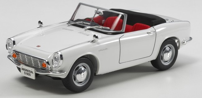Tamiya 24340 1/24 Honda S600 Convertible Sports Car This is a Tamiya 24340 1/24 Honda S600 Convertible Sports Car. While Honda first gained worldwide acclaim for their motorcycles, they were also quick to branch out into manufacturing vehicles of the 4-wheeled kind. The Tokyo Motor Show in 1962 was the stage that they chose to debut their S500 roadster, which was quickly followed up in 1964 by a 606cc engine successor - the S600. That 606cc, 57hp unit was a 4-cylinder DOHC powerplant which bore close comparison even with racing engines of its day, and Honda took the creative approach of transmitting its power to the rear wheels of the car via chain drive units. A popular export to Europe and a familiar face on the racing circuit in Japan, the S600 is a vital piece of Japanese sports car heritage and a great addition to the Tamiya line-up.Key Features:?This is a 1/24 scale plastic model assembly kit. Length: 136mm, Width: 60mm. ?The high-performance 4-cylinder DOHC engine is captured in great detail, including the four carburetors and exhaust manifold. It can be appreciated at any time thanks to the opening hood parts. ?The rear of the car features depictions of the chain drive units. ?Suspension, tubing and other details are realistically rendered. ?Metal-plated parts make authentically depict bumpers, side mirrors and front grille. ?Solid synthetic rubber tires. ?Can be assembled as an open-top or closed hard-top.Condition: Factory NewOperational Status: FunctionalThis item is brand new from the factory.Original Box: YesManufacturer: TamiyaModel Number: 24340MSRP: $51.00Category 1: Other ToysCategory 2: Radio Control ToysAvailability: Ships in 1 Business Day!The Trainz SKU for this item is P12122785. Track: 12122785 - No Location Assigned - 001 - TrainzAuctionGroup00UNK - TDIDUNK