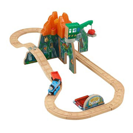 """Fisher Price CDK48 Thomas & Friends Wooden Railway Volcano Park Deluxe This is a Fisher Price CDK48 Thomas & Friends™ Wooden Railway Volcano Park Deluxe Set. Inspired by the Dinos & Discoveries DVD, little conductors will have endless hours of fun recreating the adventure their way! The Dino Park is being built around the site of a volcano, and Thomas is eager to help out. When steaming around the up-and-over track, little engineers can push the button at the volcano to send a pretend piece of molten rock flying as it """"erupts""""—just as Thomas makes it to safety! The crane is there to load the pieces into Thomas' cargo car as he takes them to the X-ray station, where little conductors discover there are fossils in the lava! 28-piece set includes: Thomas, The volcano, A crane, The fossil X-ray, Track and A cargo car.Condition: Factory New (C-9All original; unused; factory rubs and evidence of handling, shipping and factory test run.Standards for all toy train related accessory items apply to the visual appearance of the item and do not consider the operating functionality of the equipment.Condition and Grading Standards are subjective, at best, and are intended to act as a guide. )Operational Status: FunctionalThis item is brand new from the factory.Original Box: Yes (P-9May have store stamps and price tags. Has inner liners.)Manufacturer: Fisher PriceModel Number: CDK48MSRP: $110.99Scale/Era: ThomasModel Type: Wooden TrainsAvailability: Ships in 2 Business Days!The Trainz SKU for this item is P12090443. Track: 12090443 - No Location Assigned - 001 - TrainzAuctionGroup00UNK - TDIDUNK"""