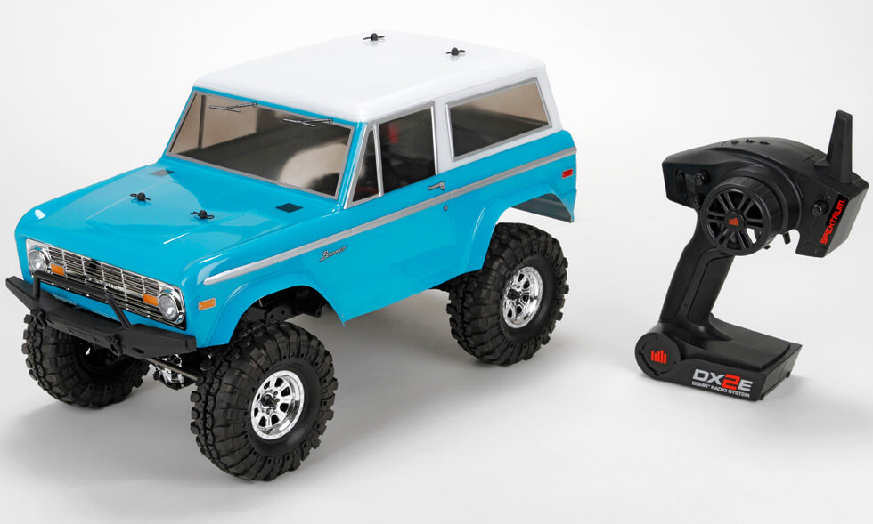 Vaterra 03031 1:10 4WD RTR 1972 Ford Bronco Ascender This is Vaterra 03031 1:10 4WD RTR 1972 Ford Bronco Ascender. Features includes stamped-steel ladder frames with adjustable wheelbase, metal gear transmission, Crawler style front bumper, heavy duty CV front shafts, licensed 1972 Ford® Bronco Body, sticky compound interco super swamper tires, powerful crawler motor and waterproof electronics, Spektrum™ DX2E 2.4GHz Radio System.Condition: Factory NewOperational Status: FunctionalThis item is brand new from the factory.Original Box: YesManufacturer: VaterraModel Number: 03031MSRP: $459.99Category 1: Model KitsCategory 2: 1:12 (and smaller scales)Availability: Ships in 1 Business Day!The Trainz SKU for this item is P12161811. Track: 12161811 - No Location Assigned - 001 - TrainzAuctionGroup00UNK - TDIDUNK