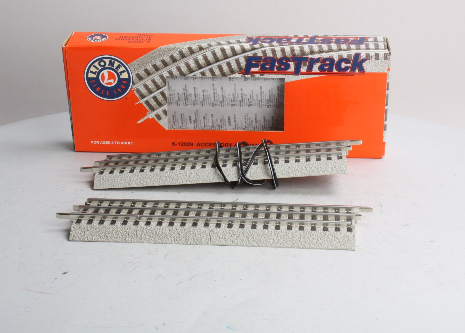 Lionel 6-12029 FasTrack Accessory Activator Pack This is a single Lionel 6-12029 FasTrack Accessory Activator Pack. With this pack you get two 5 inch insulated half sections of track and one regular 10 inch straight section. Use the insualted sections to trip accessories like crossing gates and highway signals. Run a wires from the insulated rail and the center rail of the activator track to activate your accessories when the train passes over. The straight track is included to add the same length of track to the other side of an oval for example.Condition: Factory New (C-9All original; unused; factory rubs and evidence of handling, shipping and factory test run.Standards for all toy train related accessory items apply to the visual appearance of the item and do not consider the operating functionality of the equipment.Condition and Grading Standards are subjective, at best, and are intended to act as a guide. )Operational Status: FunctionalThis item is brand new from the factory.Original Box: Yes (P-9May have store stamps and price tags. Has inner liners.)Manufacturer: LionelModel Number: 6-12029Years Manufactured: 2003 - ????MSRP: $20.99Scale/Era: O ModernModel Type: Track/Switches/Etc.Availability: Ships within 3 Business Days!The Trainz SKU for this item is P11392536. Track: 11392536 - 4002-B (Suite 2730-100)  - 001 - TrainzAuctionGroup00UNK - TDIDUNK